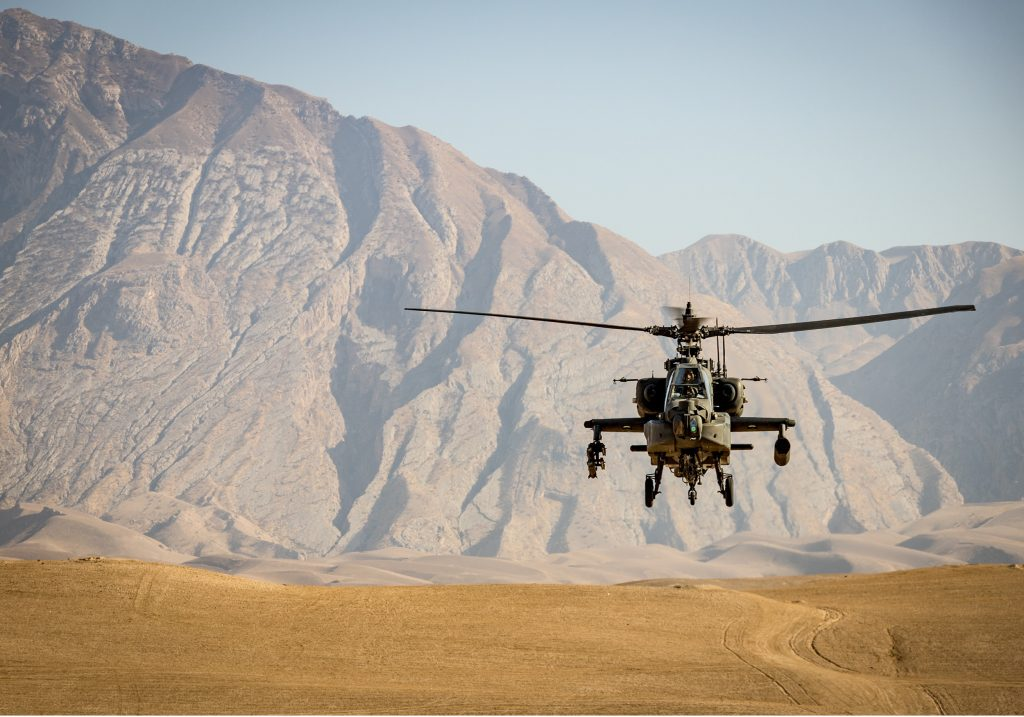 Military helicopter landing in remote area